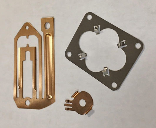 Fourslide manufacturing for light-gauge stampings