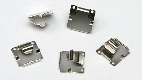 Fourslide-produced battery contacts.