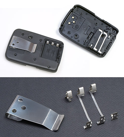 Fourslide-produced clips and battery contacts.