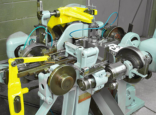 Fourslide machine forming section.
